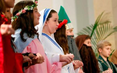 Students dressed as their favorite saints recite the Lord's Prayer during an All Saints' Day Mass at Sts. Philip & James Church in St. James, N.Y., in 2016. For many of us, the Lord's Prayer was the first prayer we learned. (CNS photo by Gregory A. Shemitz)