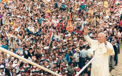 "St. John Paul II greets the World Youth Day crowd in Czestochowa, Poland, in 1992. St. John Paul wrote that ""respect for the objective rights of the worker ... must constitute the adequate and fundamental criterion for shaping the whole economy."" (CNS file photo)"