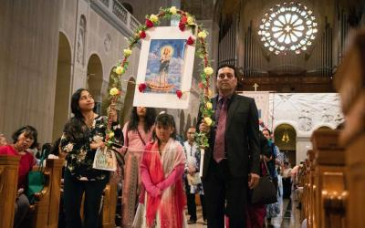 Worshippers carry an image of Mary and the Christ Child during the annual pilgrimage of Asian and Pacific Island Catholics at the Basilica of the National Shrine of the Immaculate Conception in Washington May 4, 2019. (CNS courtesy Archdiocese of Washington)
