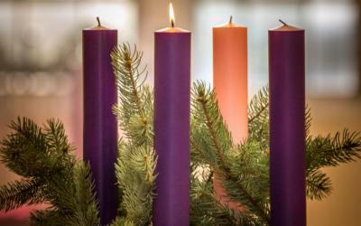 A lit candle is seen on an Advent wreath. Advent, a season of joyful expectation before Christmas, begins Dec. 1 this year. The Advent wreath, with a candle marking each week of the season, is a traditional symbol of the liturgical period.