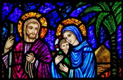 A detail of a stained-glass window from St. Edward's Church in Seattle shows Jesus, Mary and Joseph on their flight into Egypt.