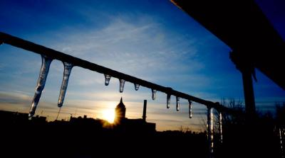In this 2009 file photo, icicles are seen as the sun sets on a frigid day in Rochester, N.Y.