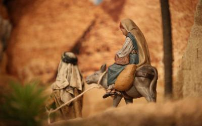 Figures of Mary and Joseph fleeing to Egypt after the birth of Jesus are seen in a display created by Father Alberto Curbelo at St. Francis de Sales Church in St. Paul, Minn.