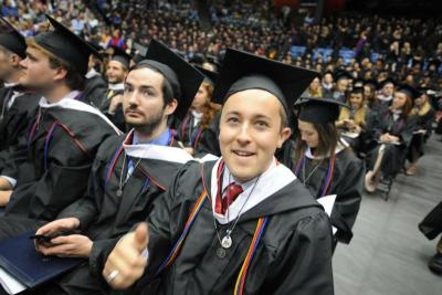 Dominic Sanfilippo, giving thumbs up, is seen May 8 during graduation at the University of Dayton in Ohio. One of 12 students who graduated with a human rights degree, Sanfilippo said the degree equips him for the world ahead.