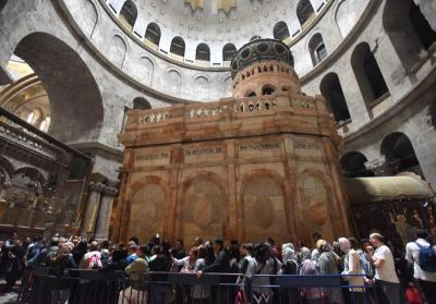 People wait to enter the Edicule, the traditional site of Jesus' burial and resurrection, March 23 at the Church of the Holy Sepulcher in Jerusalem.