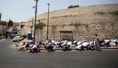 Palestinians pray on the street close to Lion's Gate in the Old City of Jerusalem July 22. Muslims have been converging outside the gate for prayers after Israel erected metal detectors near the Al-Aqsa mosque compound, in response to a July 14 shooting.
