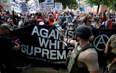 White nationalists are met by counter-protesters in Charlottesville, Va., Aug. 12 during a demonstration over a plan to remove the statue of a Confederate general from a city park.