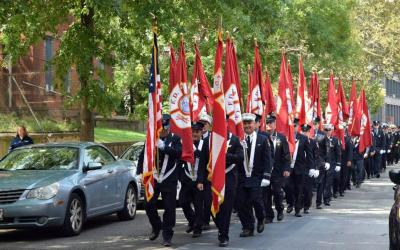 Members of New York City Fire Department Battalion 57, based in Brooklyn, march from the World Trade Center site in Manhattan to the Co-Cathedral of St. Joseph in Brooklyn for the commemoration of the Sept. 11, 2001 attacks. They carried the flags of the Fire Department and attended Mass celebrated by Father Sean Suckiel.