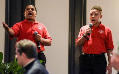 "Cardinal Shehan School choir members Kai Young and John Paige sing ""Rise Up"" to open the Archdiocese of Baltimore's annual Partners in Excellence breakfast Sept. 6. The choir's viral video is closing in on 10 million views."