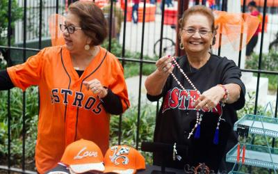 Parishioners sell handmade rosaries to baseball fans outside Annunciation Catholic Church in downtown Houston Oct. 27. The church, built in 1869, sits across the street from Minute Maid Park where the Houston Astros hosted the Los Angeles Dodgers during the 2017 World Series.