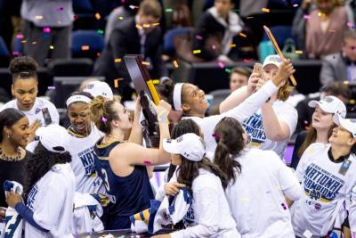 Members of the Notre Dame women's basketball team celebrate after defeating Mississippi State 61-58 April 1 in the championship game of the Final Four of the NCAA Tournament in Columbus, Ohio. It was the second time Notre Dame's women have won the title. (CNS photo by Matt Cashore/courtesy University of Notre Dame)