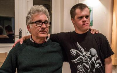 "Randall Wright, who directed the documentary ""Summer in the Forest"" about the L'Arche communities founded by Canadian Jean Vanier, poses with David, a resident who has Down syndrome. L'Arche, French for ""The Ark,"" brings together people with intellectual or physical disabilities into an intentional-living situation with able-bodied people who share life with them and treat them as equals. (CNS photo by Abramorama)"