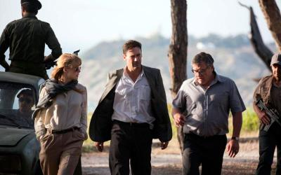 """Rosamund Pike, Jon Hamm and Dean Norris star in a scene from the movie """"Beirut."""" The Catholic News Service classification is A-III -- adults. The Motion Picture Association of America rating is R -- restricted. Under 17 requires accompanying parent or adult guardian. (CNS photo by Bleecker Street)"""