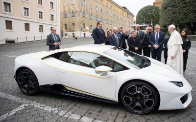 Pope Francis accepts a Lamborghini presented by representatives of the Italian automaker at the Vatican in this Nov. 15, 2017, file photo. The car was sold for $970,000 to raise money for charity. (CNS photo by L'Osservatore Romano)