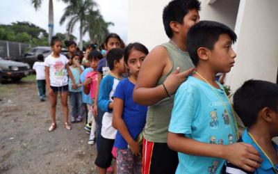Children wait in line at a shelter in Escuintla, Guatemala, June 4. The eruption of the nearby Volcano of Fire a day earlier killed at least 69 people. (CNS photo courtesy Ivan Palma, CRS)