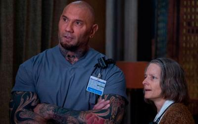 """Dave Bautista and Jodie Foster star in a scene from the movie """"Hotel Artemis."""" The Catholic News Service classification is L -- limited adult audience, films whose problematic content many adults would find troubling. The Motion Picture Association of America rating is R -- restricted. Under 17 requires accompanying parent or adult guardian.(CNS photo by Global Road Entertainment)"""