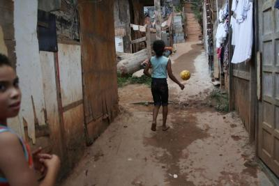 Girls play in the Tribo neighborhood near Sao Paulo, Brazil, May 16. The World Day of the Poor -- to be marked each year on the 33rd Sunday of ordinary time -- will be celebrated Nov. 18. (CNS photo by Fernando Bizerra Jr., EPA)