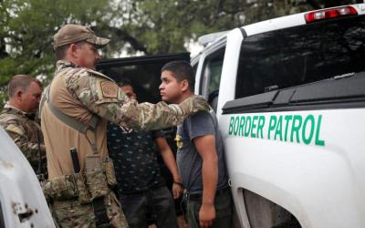 Members of the Border Patrol Search, Trauma, and Rescue Unit near Falfurrias, Texas, apprehend an immigrant from Guatemala June 19. Pope Francis told Reuters he stands with the U.S. bishops in their condemnation of the Trump administration's immigration policy has led to children being held in government shelters while their parents are detained in federal prison. (CNS photo by Adrees Latif/Reuters)