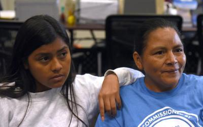 Honduran migrants Christhel Nohelia Barahona Sanchez, 15, and her mother, Sandra Elizabeth Sanchez, speak with media July 26 after being reunited at Catholic Charities in San Antonio. (CNS photo by Callaghan O'Hare, Reuters)