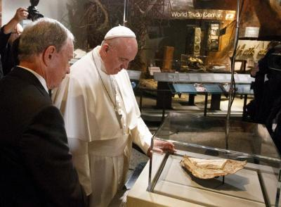 In this 2015 file photo, Pope Francis looks at a Bible fragment found in the rubble following the Sept. 11 terrorist attack in lower Manhattan. (CNS photo by Paul Haring)