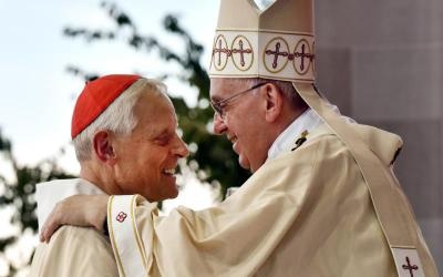 Pope Francis greets Washington Cardinal Donald W. Wuerl during a Mass in 2015 outside the Basilica of the National Shrine of the Immaculate Conception in Washington. Cardinal Wuerl announced Sept. 11 that he will meet soon with Pope Francis to discuss the resignation he submitted three years ago when he turned 75. (CNS photo by Matthew Barrick)