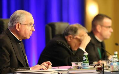 Archbishop Jose H. Gomez of Los Angeles, vice president of the U.S. Conference of Catholic Bishops, gives the opening prayer Nov. 13 at the bishops' fall general assembly in Baltimore. Also pictured are Cardinal Daniel N. DiNardo of Galveston-Houston, USCCB president, and Msgr. J. Brian Bransfield, USCCB general secretary. (CNS photo by Bob Roller)