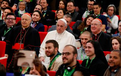 Pope Francis is pictured next to Cardinal Lorenzo Baldisseri, secretary-general of the Synod of Bishops, and Cardinal Kevin Farrell, head of the Vatican's Dicastery for Laity, the Family and Life, during a group photo at a pre-synod gathering of youth delegates in Rome March 19. The Synod of Bishops on young people, the faith and vocational discernment will take place Oct. 3-28 at the Vatican. (CNS photo by Paul Haring)