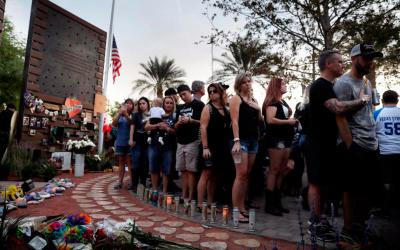 People attend a vigil in a Las Vegas healing garden Oct. 1 during a vigil on the first anniversary of the mass shooting that took place at a music festival on the Las Vegas Strip. The gunman killed at least 58 people and wounded more than 500 before law enforcement entered the shooter's room and killed him. It was the deadliest mass shooting committed by a single person in the U.S. (CNS photo by Isaac Brekken/EPA)