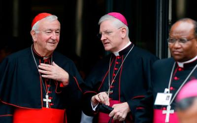 Cardinal Vincent Nichols of Westminster, England, talks with Archbishop Leo Cushley of St. Andrews and Edinburgh, Scotland, as they leave a session of the Synod of Bishops on young people, the faith and vocational discernment at the Vatican Oct. 11. (CNS photo by Paul Haring)