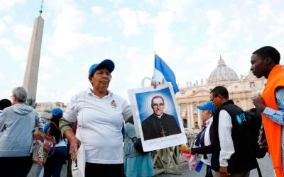 Milandro DeJesus holds a picture of St. Oscar Romero before Pope Francis' celebration of the canonization Mass for seven new saints in St. Peter's Square at the Vatican Oct. 14. Among the new saints are St. Paul VI and St. Oscar Romero.(CNS photo by Paul Haring)