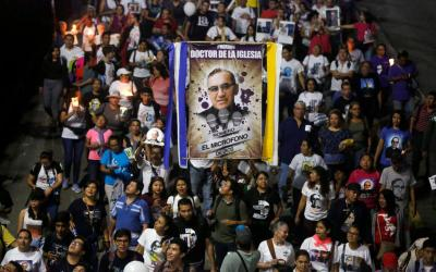 People carry a banner of St. Oscar Romero during an Oct. 13 procession in San Salvador, El Salvador. Pope Francis celebrated the canonization Mass for St. Oscar Romero and six other new saints in St. Peter's Square Oct. 14 at the Vatican. (CNS photo by Jose Cabezas/Reuters)