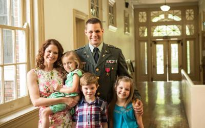 """Army Chaplain Darren Turner poses in an undated photo with his wife, Heather, and their three children, Meribeth, Samuel and Ellie, after an awards ceremony for the film """"Indivisible."""" The film recounts Darren's experiences as an Army chaplain during the Iraq War, how the pressures of that ministry led to the unraveling of his marriage and ultimately how that relationship was healed. (CNS photo by courtesy Provident Films LLC and The WTA Group, LLC)"""