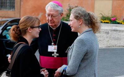 Bishop Lucas Van Looy of Gent, Belgium, introduces pre-synod delegate Anne Lien Boone, left, to synod delegate Marguerite-Marie Le Hodey of Belgium before a session of the Synod of Bishops on young people, the faith and vocational discernment at the Vatican Oct. 16. (CNS photo by Paul Haring)