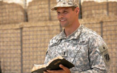 """Justin Bruening stars as U.S. Army Chaplain Darren Turner in a scene from the movie """"Indivisible."""" The Catholic News Service classification is A-II -- adults and adolescents. The Motion Picture Association of America rating is PG-13 -- parents strongly cautioned. Some material may be inappropriate for children under 13. (CNS photo courtesy Provident Films)"""