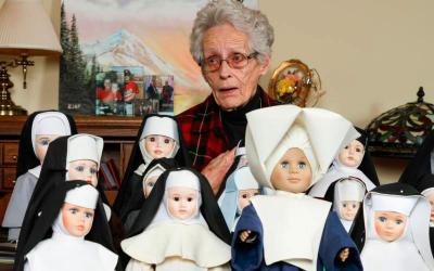 Margaret Alsup of Cumming, Ga., stands behind some of the 75 nun dolls Dec. 21, 2017, that she collected over the years. All of the dolls, which are clothed in authentic habits, have been donated to the Archdiocese of Atlanta's Office of Archives and Records. (CNS photo by Michael Alexander/Georgia Bulletin)