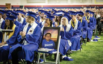 A chair sits empty in honor of Kendrick Castillo at the STEM School Highlands Ranch graduation in Colorado