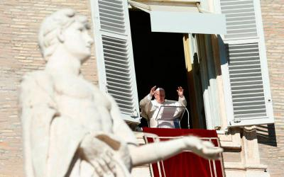 Pope Francis leads the Angelus from the window of his studio overlooking St. Peter's Square at the Vatican Jan. 1, the feast of Mary, Mother of God.(CNS photo by Paul Haring)