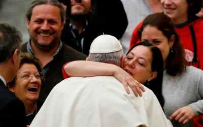 Pope Francis embraces a woman during his general audience in Paul VI hall at the Vatican Jan. 2. (CNS photo by Paul Haring)