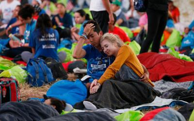 A couple wake up before Pope Francis' celebration of Mass for World Youth Day pilgrims at St. John Paul II Field in Panama City Jan. 27, 2019. (CNS photo by Paul Haring)