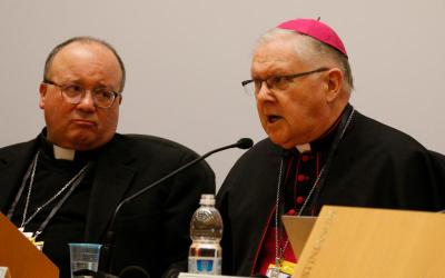 Archbishop Charles Scicluna of Malta and Archbishop Mark Coleridge of Brisbane, president of the Australian bishops' conference, attend a press briefing after the opening session of the meeting on the protection of minors in the church at the Vatican Feb. 21, 2019. (CNS photo by Paul Haring)