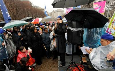 """U.S. Rep. Alexandria Ocasio-Cortez, D-N.Y., addresses immigration rights activists during a rally calling for """"permanent protections for Temporary Protected Status holders"""" in front of the White House in Washington Feb. 12, 2019. (CNS photo by Jim Bourg/Reuters)"""