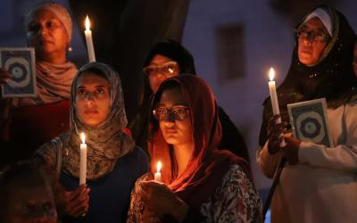 Women hold candles during a vigil outside St. George's Anglican Cathedral in Cape Town, South Africa, March 17, 2019, for the victims of the March 15 mosque attacks in Christchurch, New Zealand. (CNS photo by Mike Hutchings/Reuters)