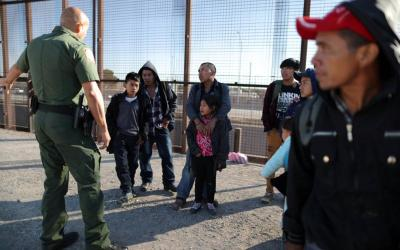 A group of Central American migrants is questioned about their children's health after surrendering to U.S. Border Patrol agents south of the U.S.-Mexico border fence in El Paso, Texas, March 6, 2019. (CNS photo by Lucy Nicholson/Reuters)