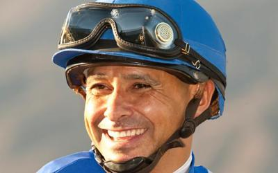 Jockey Mike Smith celebrates after winning the Grade I, $250,000 Santa Anita Sprint Championship aboard Points Offthebench, Oct. 5, 2013, at Santa Anita Park in Arcadia Calif. (CNS photo by Benoit photo)