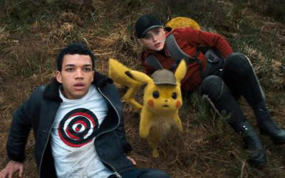 """Justice Smith, Detective Pikachu (voiced by Ryan Reynolds) and Katrhyn Newton appear in the movie """"Pokemon Detective Pikachu."""" (CNS photo/Warner Bros."""