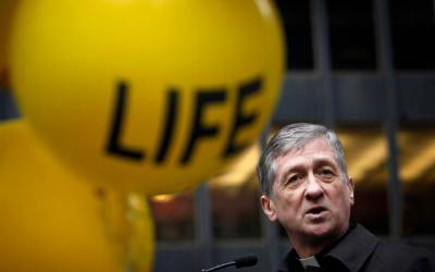 """Chicago Cardinal Blase J. Cupich, pictured in a Jan. 18, 2015, photo, and other Illinois bishops, are urging the state's lawmakers to take no action on a bill that """"dramatically rewrites current abortion law, and goes further than Roe v. Wade."""" (CNS photo by Karen Callaway/Catholic New World)"""