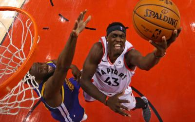 Toronto Raptors forward Pascal Siakam (43) shoots the ball against Golden State Warriors forward Draymond Green (23) in game one of the 2019 NBA Finals at Scotiabank Arena in Toronto May 30, 2019. (CNS photo by Gregory Shamus-USA TODAY Sports via Reuters)