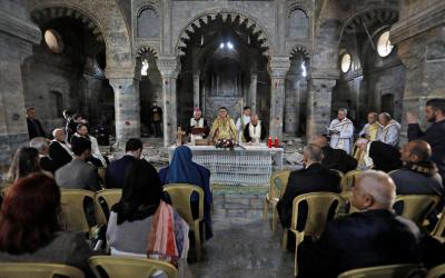 Syriac Catholic Archbishop Yohanna Moshe of Mosul, Iraq, center, concelebrates the liturgy at St. Thomas Syriac Catholic Church in the old city of Mosul Feb. 28, 2019. (CNS photo by Khalid al-Mousily/Reuters)