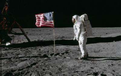 "Astronaut Edwin ""Buzz"" Aldrin, lunar module pilot of the first lunar landing mission, poses for a photograph beside the deployed U.S. flag during an Apollo 11 extra-vehicular activity on the lunar surface July 20, 1969. (CNS photo courtesy NASA)"