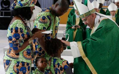 Pope Francis blesses a girl as her family presents offertory gifts during the closing Mass of the World Meeting of Families along Benjamin Franklin Parkway in Philadelphia Sept. 27, 2015. (CNS photo by Paul Haring)